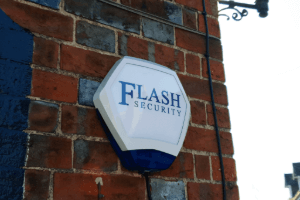 Flash security intruder alarm mounted on the wall